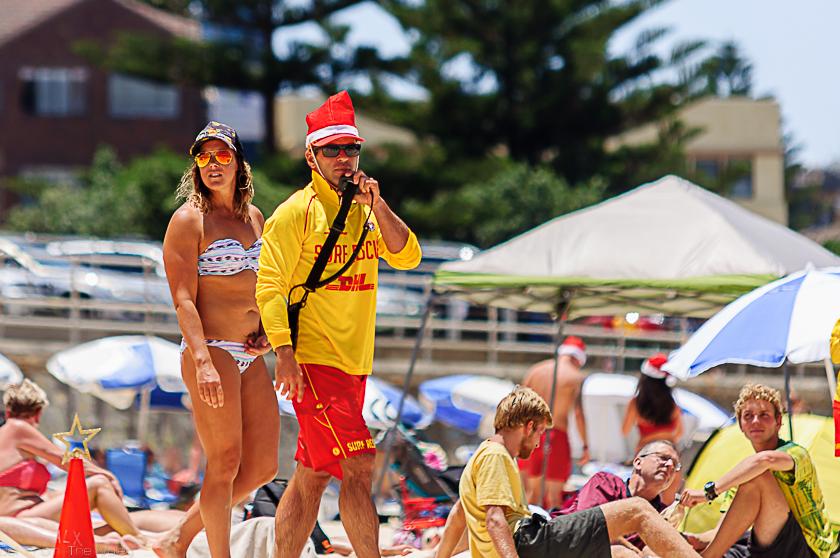 Volunteer Lifeguard with Santa hat on Christmas Day at Bondi Beach