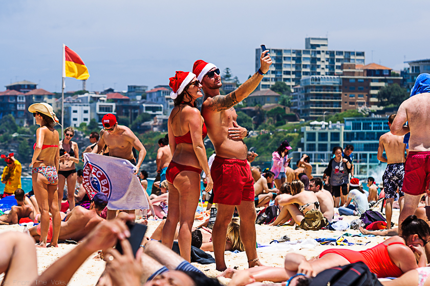 A couple taking a selfie at famous Bondi Beach on Christmas Day