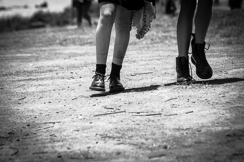 Two girls wearing Doc Martens boots in summer